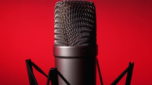 Cover Image for Studio Condenser Microphone Rotates on Red Background