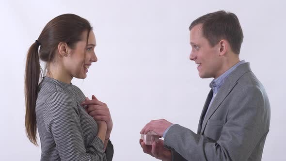 Thumbnail for Portrait of Genuine Man in Gray Suit Gives Small Box To Woman
