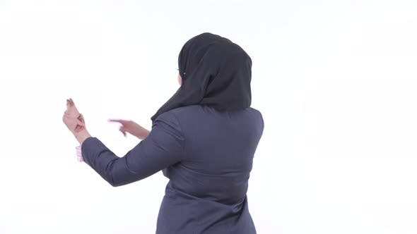 Thumbnail for Rear View of Young African Muslim Businesswoman Touching Something