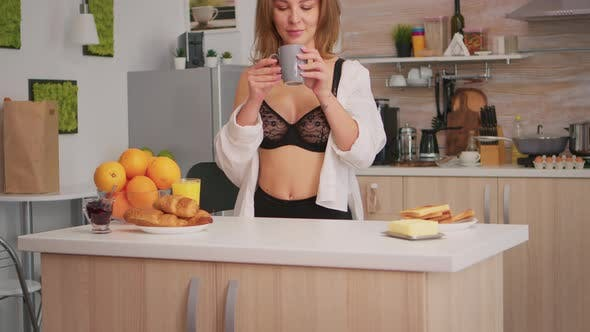 Thumbnail for Woman in Lingerie Drinking Coffee