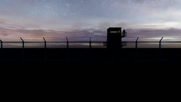 Thumbnail for Soldier Watching the Military Watchtower at Night