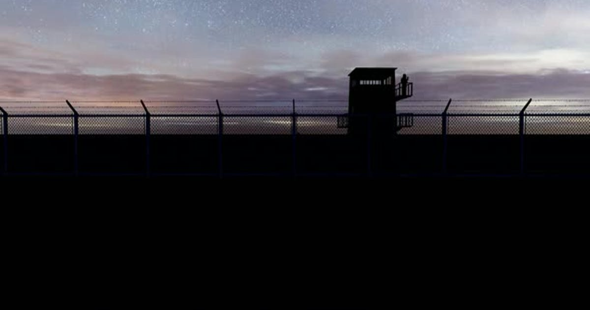 Soldier Watching the Military Watchtower at Night