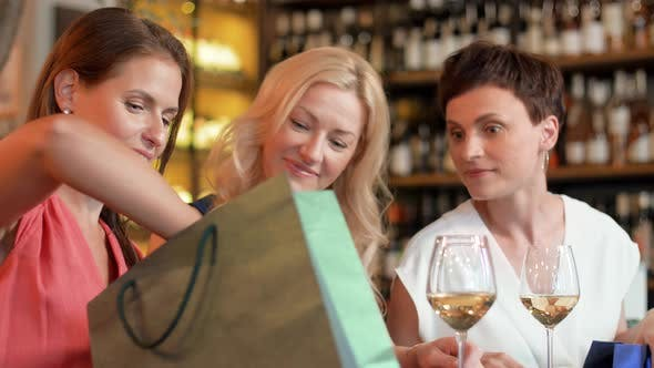 Thumbnail for Women with Shopping Bags at Wine Bar or Restaurant