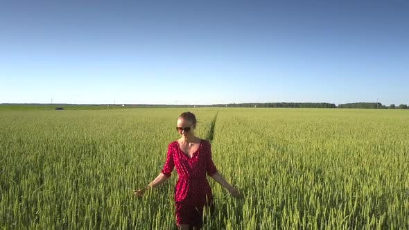 Thumbnail for Flycam Films Lady Wearing Short Red Dress and Sunglasses