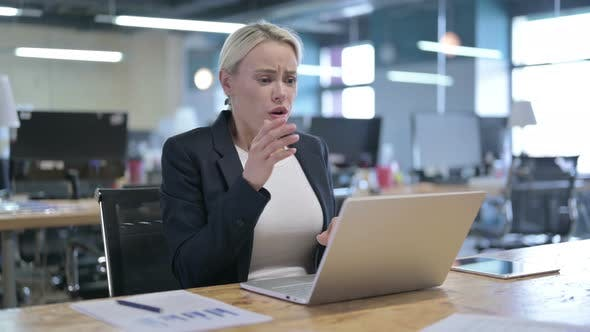 Shocked Businesswoman Reacting To Failure at Work