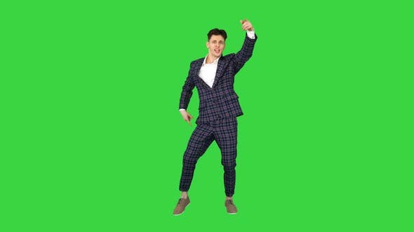 Thumbnail for Happy Successful Businessman Dancing In a Crazy Way on a Green Screen, Chroma Key