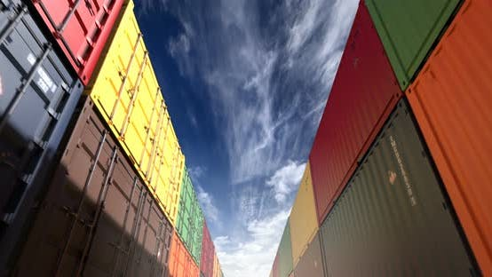 Thumbnail for Stacks of Shipping Containers under Afternoon Cloudscape