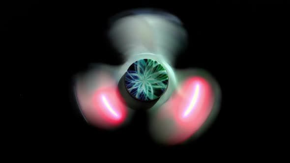 Thumbnail for Glowing Spinner Spins On A Black Background 2