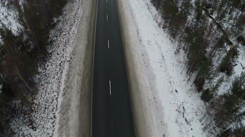 Aerial shot of empty winter road