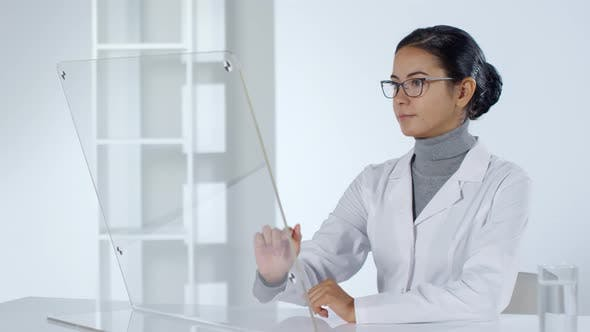 Thumbnail for Female Doctor Working on Futuristic PC