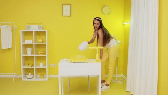 Young Lady Is Cleaning Creative Office