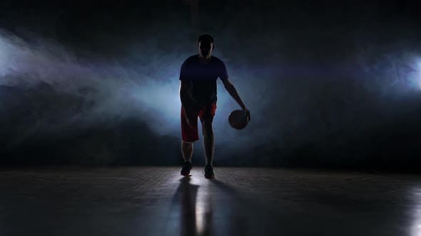 Thumbnail for One Young Adult Man, Basketball Player Dribble Ball, Dark Indoors Basketball Court Slow Motion