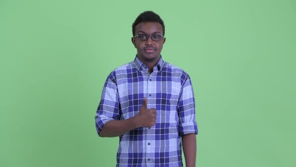 Thumbnail for Happy Young African Hipster Man Giving Thumbs Up