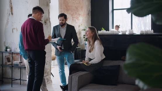Thumbnail for Comfortable Workplace Atmosphere. Positive Young Millennial Business People Chat at Trendy Light