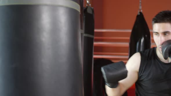 Thumbnail for Male Boxer Practicing Punches in Gym
