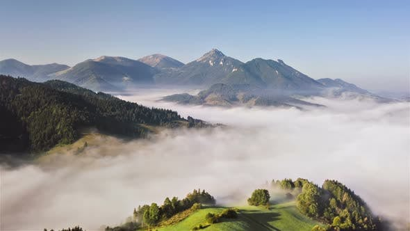 Thumbnail for Aerial View of Foggy Clouds in Green Mountains