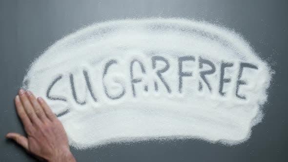 Sugarfree word handwriting revealing. Stop diabetes. Obesity, cardiovascular diseases.