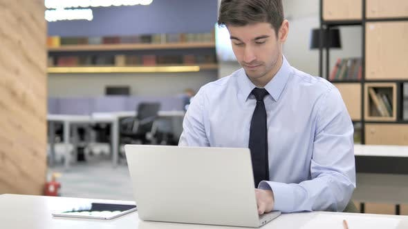 Thumbnail for Businessman Working on Laptop