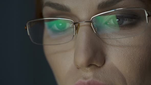 Cover Image for Laptop Screen Reflected in Glasses, Female Working on Laptop, Concentration
