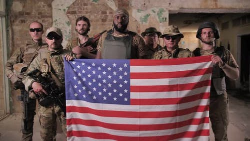 Squad of Diverse Military Men Holding USA Flag