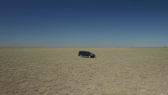 Thumbnail for Black Pickup In Middle Of Plains