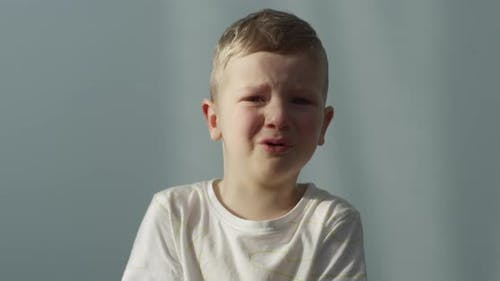 Portrait Of A Little Boy Crying Indoors Shot On Red Camera