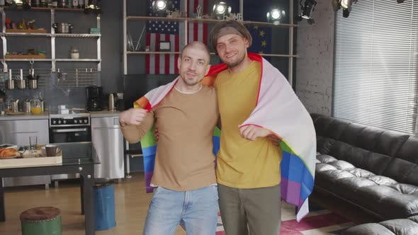 Homosexual Couple with Rainbow Flag