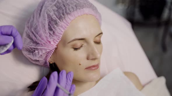 Thumbnail for A Beautiful Woman is Lying on the Couch in the Office of a Beautician on the Botox Procedure