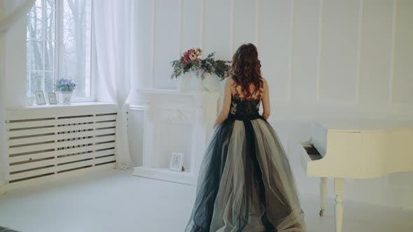 Girl dressed in evening dress