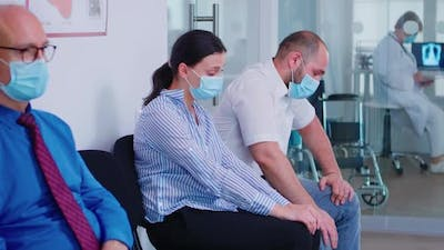 Young Couple Crying in Hospital Waiting Area