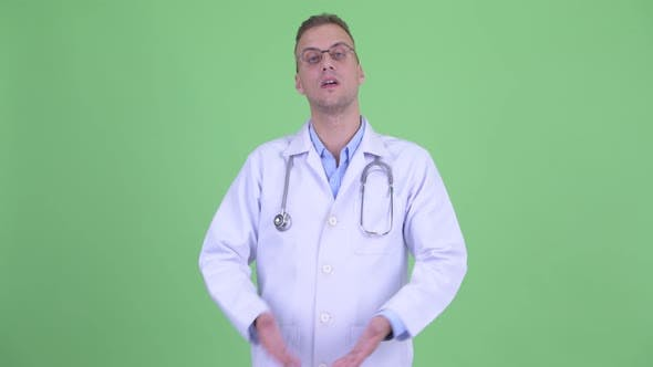Cover Image for Happy Handsome Man Doctor Presenting Something