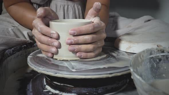 Thumbnail for Potter get clay pot out of pottery wheel