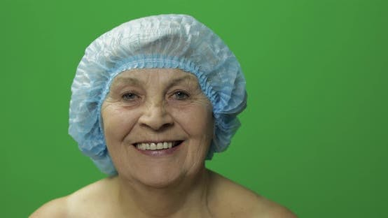 Thumbnail for Elderly Female in Protective Hat. Doctor Making Facial Injections for Patient