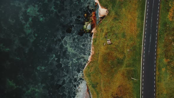 Thumbnail for Top View Drone Flying Along Beautiful Autumn Bay Road Close To Ethereal Eroded Sandstone Sea Shore