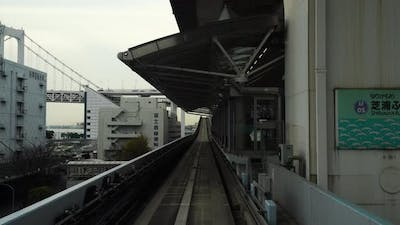 Scenery of a train traveling on the rail of Yurikamome Line in Tokyo