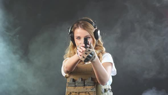 Thumbnail for Woman Soldier in Military Uniform Developing Her Shooting Skills