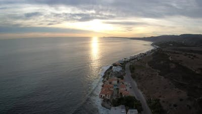 Flying Above Waterfront Luxury Homes In Malibu California At Sunset