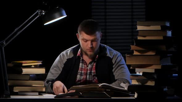 Cover Image for Guy Looking for the Right Information in the Book and Could Not Find It. Black Background. Time