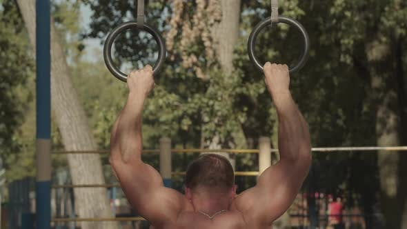 Thumbnail for Strong Athlete Doing Push-ups on Gymnastic Rings