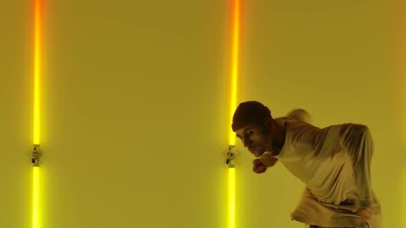 Stylish Young Man Dancing and Performing Modern Hip Hop Choreography