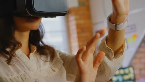 Thumbnail for Businesswoman trying helmet virtual reality in office.