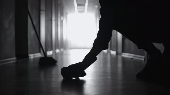 Thumbnail for Silhouette of Unrecognizable Janitor Cleaning Floor