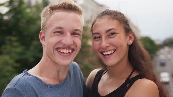 Cover Image for Multi-ethnic Teenage Couple Having Fun Laughing in City