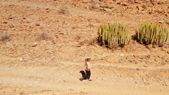 Thumbnail for Young Beautiful Lady Jogging in the Desert