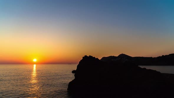 Thumbnail for Timelapse Sunset on Beautiful Island with Silhouette Cliffs