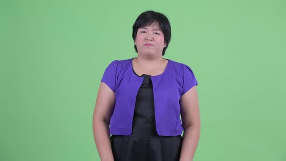 Cover Image for Stressed Young Overweight Asian Woman Getting Bad News