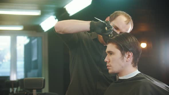 Thumbnail for Barber Brushing His Young Client's Wet Hair in Sections for Cutting