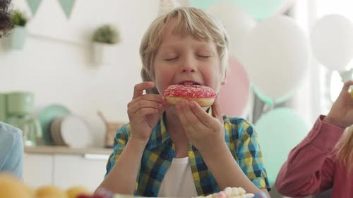 Boy Eating Donut on Party