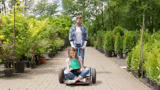 Thumbnail for Woman Gardner Sitting on Wagon in Garden and Doing Paperwork