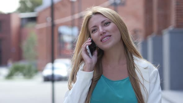 Thumbnail for Outdoor Beautiful Girl Talking on Phone, Smartphone